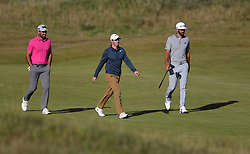 South Africa's Charl Schwartzel, Northern Ireland's Rory McIlroy and USA's Dustin Johnson walk the fairway during day one of The Open Championship 2017 at Royal Birkdale Golf Club, Southport.