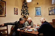 MACEDONIA, January 2016. City of Skopje. Men hang out in a Cafana, a typical Macedonian bar and restaurant. (Photo by Gregor Zielke)