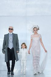 File photo - Designer Karl Lagerfeld, his godson Hudson Kroenig and Model Cara Delevingne walk at the end of Chanel Spring-Summer 2014 Haute-Couture collection show held at the Grand Palais, in Paris, France on January 21, 2014. Karl Lagerfeld died on Monday at age 85. One who may inherit is his godson Hudson. Hudson's dad, model Brad Kroenig, is like 'family' to Lagerfeld. Hudson began modeling for Chanel at age two and had continued to pop up on the runway ever since. Photo by Christophe Guibbaud/ABACAPRESS.COM