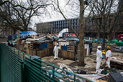 Workers wearing white body suits take part in an operation to remove environmental activists from anti-HS2 campaign group HS2 Rebellion from tunnels beneath Euston Square Gardens on 6th February 2021 in London, United Kingdom. The activists entered tunnels dug by them beneath the site eleven days ago in order to seek to protect its trees from felling in connection with the HS2 high-speed rail project.