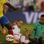 Landon Donovan, USA, challenges for the ball with goalkeeper Máximo Banguera, Ecuador, after hitting the post with a shot during his farewell match during the USA Vs Ecuador International match at Rentschler Field, Hartford, Connecticut. USA. 10th October 2014. Photo Tim Clayton