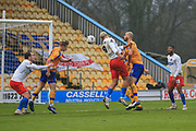 Paul McCallum (9) of Dagenham & Redbridge  heads the ball goal wards during the The FA Cup match between Mansfield Town and Dagenham and Redbridge at the One Call Stadium, Mansfield, England on 29 November 2020.