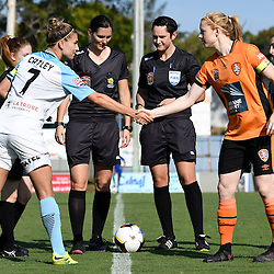BRISBANE, AUSTRALIA - DECEMBER 4: Stephanie Catley of the City and Clare Polkinghorne of the Roar shake hands during the round 5 Westfield W-League match between the Brisbane Roar and Melbourne City at AJ Kelly Field on December 4, 2016 in Brisbane, Australia. (Photo by Patrick Kearney/Brisbane Roar)