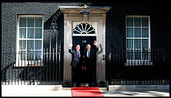 The British Prime Minister David Cameron greets US President Barack Obama on the steps of Number 10 Downing Street, London, On day 2 of his UK tour, Wednesday May 25,2011. Photo By Andrew Parsons/i-Images