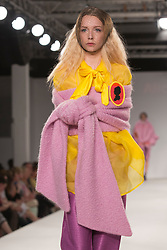 © Licensed to London News Pictures. 31/05/2014. London, England. Collection by Alice Houghton from UCLAN, University of Central Lancashire. Graduate Fashion Week 2014, Runway Show at the Old Truman Brewery in London, United Kingdom. Photo credit: Bettina Strenske/LNP