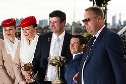 © Licensed to London News Pictures. 06/11/2012. Trainer Robert Hickmott, jockey Brett Prebble and winning owner Nick Williams, pose with the Melbourne Cup trophy after Green Moon won the Emirates Melbourne Cup during the Emirates Melbourne Cup at the Flemington Racecourse, Melbourne. Photo credit : Asanka Brendon Ratnayake/LNP
