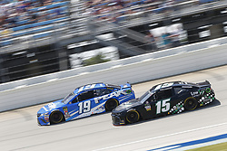 July 1, 2018 - Joliet, Illinois, United States of America - Daniel Suarez (19) battles for position during the Overton's 400 at Chicagoland Speedway in Joliet, Illinois  (Credit Image: © Justin R. Noe Asp Inc/ASP via ZUMA Wire)