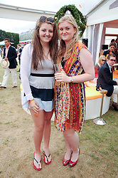 Left to right, VENETIA MONTGOMERIE and OLIVIA MONTGOMERIE at the Veuve Clicquot Gold Cup polo final held at Cowdray Park, Midhurst, West Sussex on 18th July 2010.
