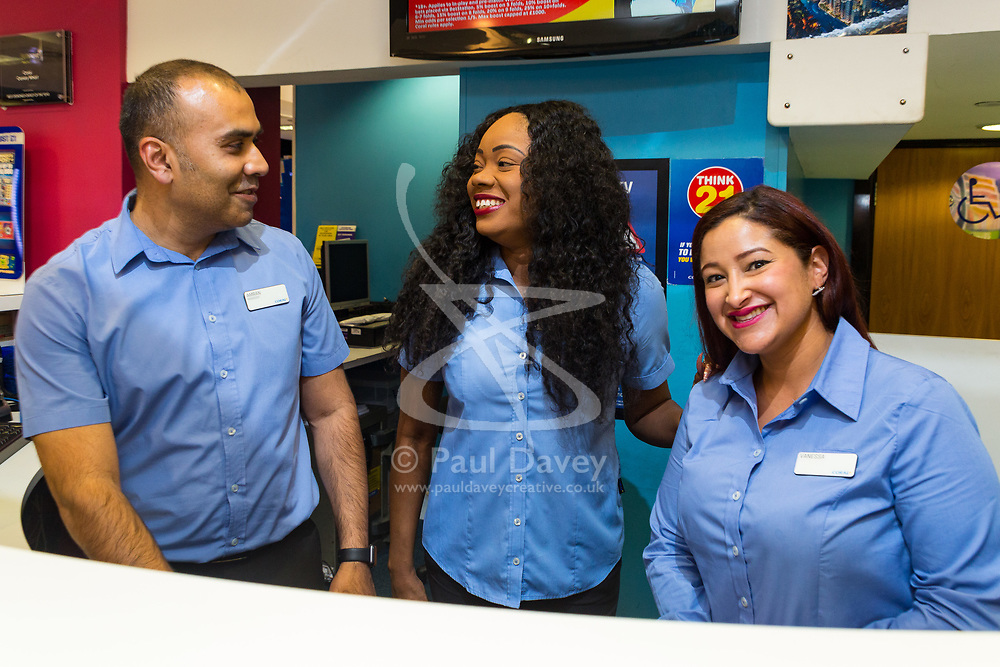 Betting Shop Manager-of-the-Year finalist Amran Al-Haque shares a joke with staff members Elaine Norbert and Vanessa Lopez at Coral, 1 Canada Square, Canary Wharf, London, November 08 2018.