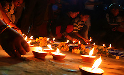 April 25, 2018 - Kathmandu, Nepal - Nepalese people participate in a candlelight vigil organized in memory of the victims souls to mark the third anniversary of the massive 2015 earthquake at ruins of Kastamandap temple,Kathmandu,Nepal. (Credit Image: © Archana Shrestha/Pacific Press via ZUMA Wire)