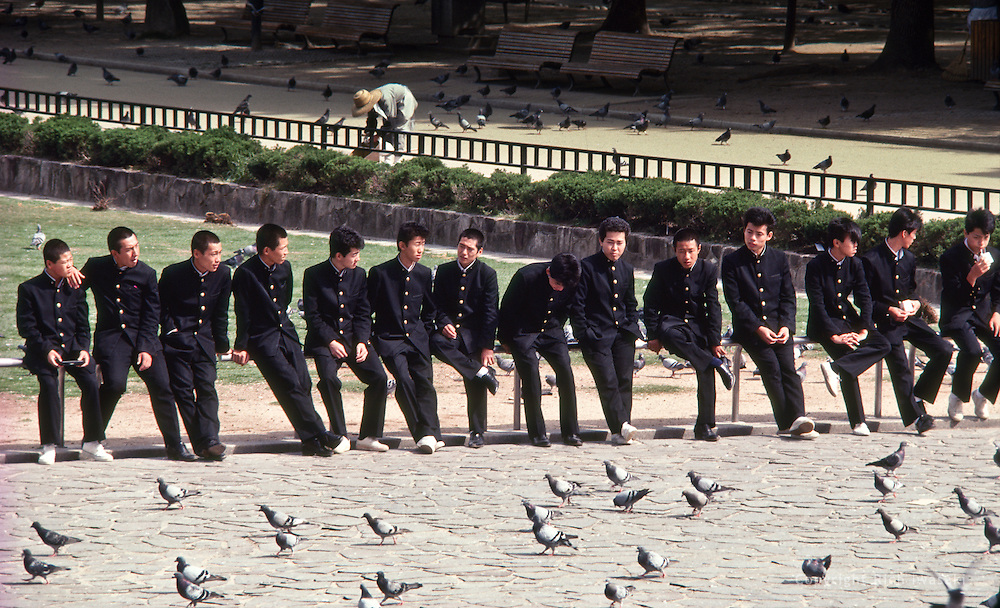 High school students on field trip relax near Hiroshima Peace Memorial Park, Hiroshima, Hiroshima Prefecture, Japan