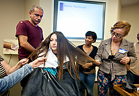 Cosmetologists at Zerran International Corp, participate in  a class of in the use of the company's hair straightening products in Pacoima, CA. July 18, 2012. Photo by David Sprague