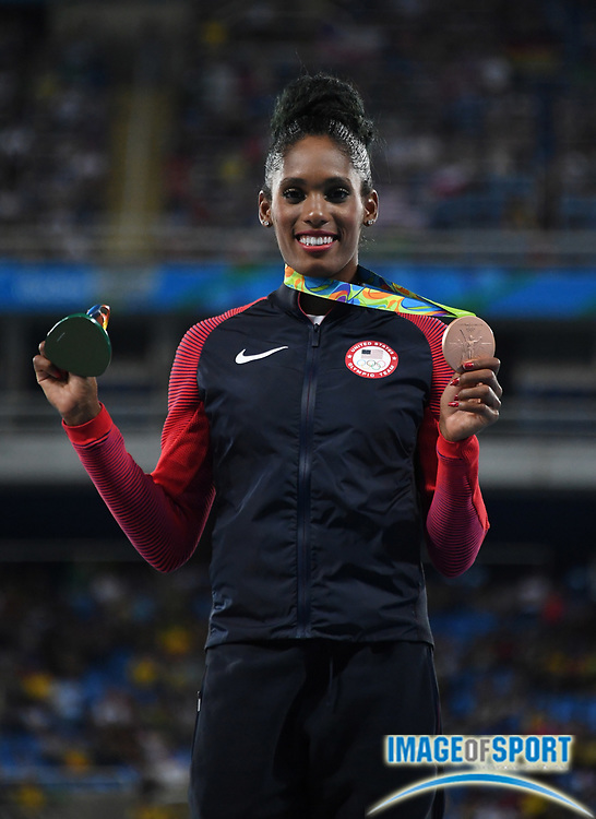 Aug 18, 2016; Rio de Janeiro, Brazil; Kristi Castlin (USA) poses with the bronze medal after placing third in the women's 100m hurdles during the 2016 Rio Olympics at Estadio Olimpico Joao Havelange.