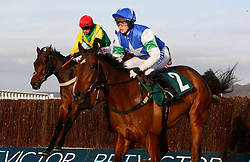 Finian's Oscar ridden by Bryan Cooper trails Coo Star Sivola ridden by Lizzie Kelly before going on to win The Steel Plate and Sections Novices' Steeple Chase Race run during day one of the November Meeting at Cheltenham Racecourse, Cheltenham.