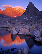 Thunderbolt Peak, North Palisade and Isosceles Peak reflected at sunset in one of the Dusy Lakes, Dusy Basin, Sierra Nevada, Kings Canyon National Park, California.