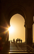 Silhouettes of people on stairs of Hassan II Mosque at sunset, Casablanca, Morocco