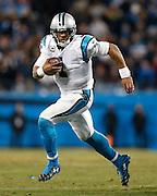 CHARLOTTE, NC - JAN 24:  Quarterback Cam Newton #1 of the Carolina Panthers scrambles during the NFC Championship game against the Arizona Cardinals at Bank of America Stadium on January 24, 2016 in Charlotte, North Carolina.