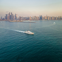 Aerial view of a yacht in the bay of Dubai, U.A.E.