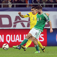 ROMANIA, Bucharest : Romania's Ovidiu Hoban (L) and Northern Ireland's Oliver Norwood (R) vie for the ball during the Euro 2016 Group F qualifying football match Romania vs Northern Ireland in Bucharest, Romania on November 14, 2014.