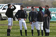 Jockeys out for a walk on the course before the start of the Grand National Meeting at Aintree, Liverpool, United Kingdom on 6 April 2019.