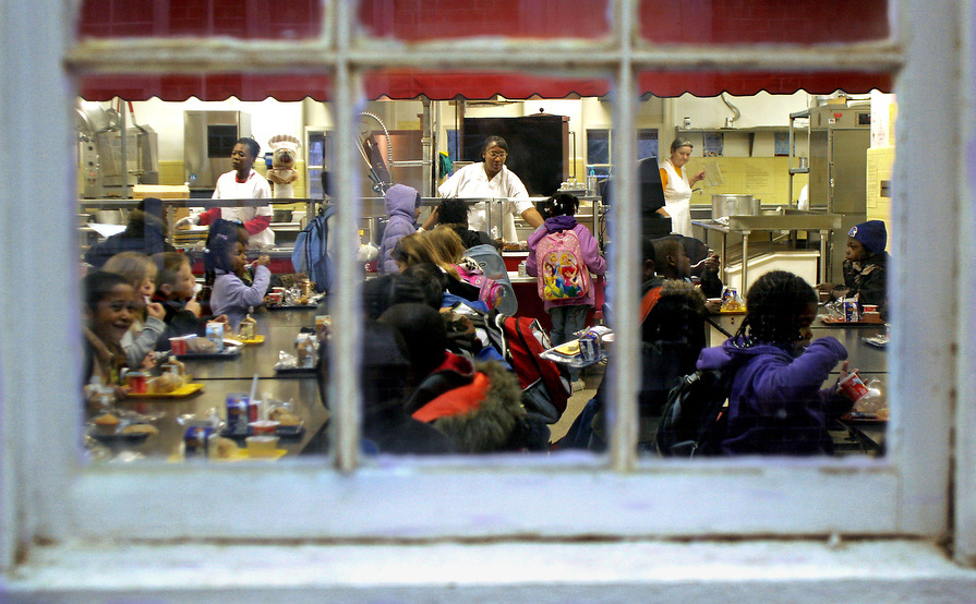 East Elementary students eat breakfast in the cafeteria which was built in the late 1940's. 84% of the students receive free or reduced meals.