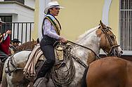 A woman riding in the Los Chagras parade in Cotacachi, Ecuador.