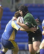 Reading, Berkshire, 20th April 2003,  ZURICH PREMIERSHIP RUGBY, The Madejski Stadium,  [Mandatory Credit: Peter Spurrier/Intersport Images],<br /> <br /> Zurich Premiership Rugby London Irish v Leeds<br /> Exiles Mike Worsley right  tackled by Mark Regan