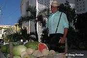 Mennonite farmer from Orange Walk peddles melons on street in San Pedro, Ambergris Caye, Belize, Central America