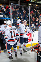 KELOWNA, BC - OCTOBER 12: Orrin Centazzo #19 of the Kamloops Blazers high fives teammates as they head to the dressing room after the win against the Kelowna Rockets at Prospera Place on October 12, 2019 in Kelowna, Canada. (Photo by Marissa Baecker/Shoot the Breeze)