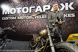 Motor Garage Moscow's booth with their custom Harleys on display in the Custom and Tuning Show in Moscow, Russia. Friday April 21, 2017. Photography ©2017 Michael Lichter.