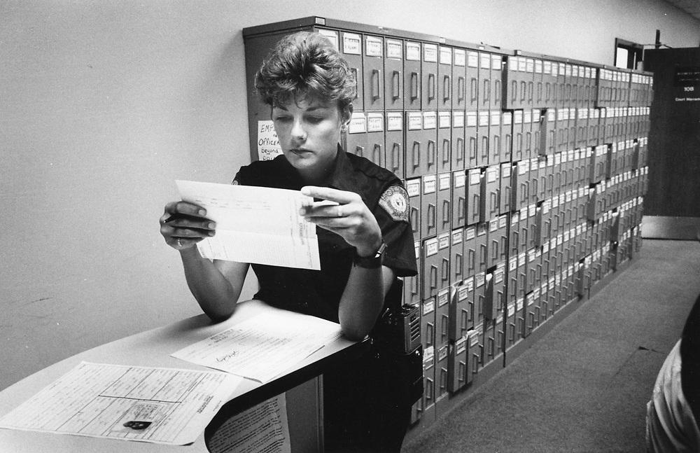 ©1992 female police officer at work,  Austin, Texas