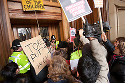 © under licence to London News Pictures 30/11/2010 Birmingham students marched to Birmingham Council House and entered the building earlier today. It is believed 30 students forced their way into the Council House. Picture shows students on the steps of the Council House attempting to gain entry..Picture credit: Dave Warren/London News Pictures....