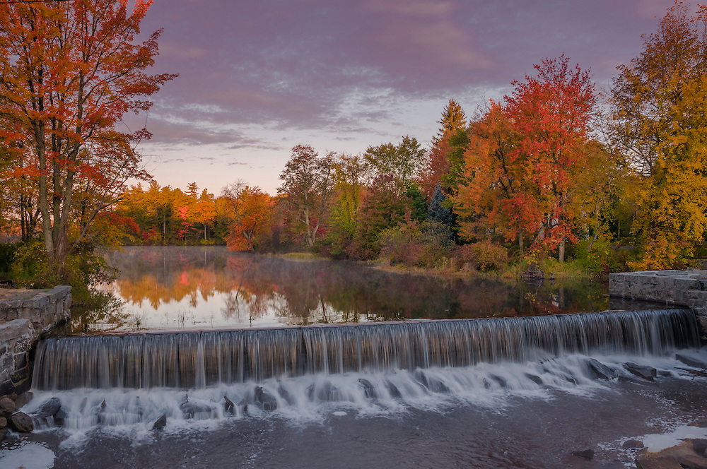 Falls at old mill site dam with fall colors, Townsend Harbor, MA
