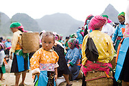 Portrait of a young Hmong child in a market, Vietnam, Southeast Asia