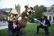 Stop Trump, Stop the Trade Deal protest on 24th October 2020 in Parliament Square, London, United Kingdom. The protest and press call featured a pantomime cow being chased by a Donald Trump look-alike as well as a business man with a giant hormone syringe. Activists dressed up as chckens demanded  not to be chlorinated. The nationwide day of action was organised by Global Justice Now, War on Want, Keep Our NHS Public, Traidcraft, We Own It, Open Rights Group, SumOfUs, Stop Trump and Another Europe is Possible.
