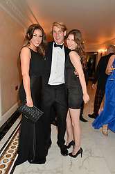 Left to right, model LUCY PINDER, FREDDIE HUNT son of the late F1 World Champion James Hunt and MISS ISABEL SIDOROINICZ at the David Shepherd Wildlife Foundation 30th anniversary Wildlife Ball at The Dorchester, Park Lane, London on 10th October 2014.