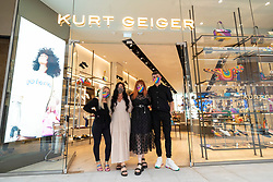 Edinburgh, Scotland, UK. 24 June 2021. First images of the new St James Quarter which opened this morning in Edinburgh. The large retail and residential complex replaced the St James Centre. Pic; Staff at Kurt Geiger pose after opening doors for the first time. Iain Masterton/Alamy Live News