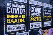 Covid-19 test posters in three different languages placed in the community noticeboard in Wapping, Tower Hamlets on 30th January 2021 in London, United Kingdom. The posters, in Somali, English and Bangladeshi point the way to find a coronavirus test centre if symptoms are occurring.