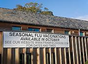 Seasonal flu vaccinations available poster sign on Framfield health centre, Woodbridge, Suffolk, England