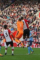 Football - 2017 / 2018 Premier League - Southampton vs. Newcastle United<br /> <br /> Southampton's Virgil van Dijk gets his head to the in front of Rob Elliot of Newcastle United only for his header to go wide at St Mary's Stadium Southampton<br /> <br /> COLORSPORT/SHAUN BOGGUST