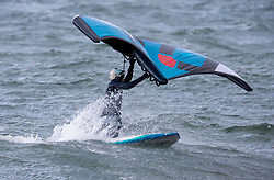 Wing Foiling is the latest-born board sport : it consists in managing a wing not attached to the board and carried with two hands while standing on a hydrofoil mounted on a short stand up paddle board. Enthusiasts were out in the sea at Ganavan Sands, Oban enjoying ideal conditions today.…….. (c) Stephen Lawson | Edinburgh Elite media