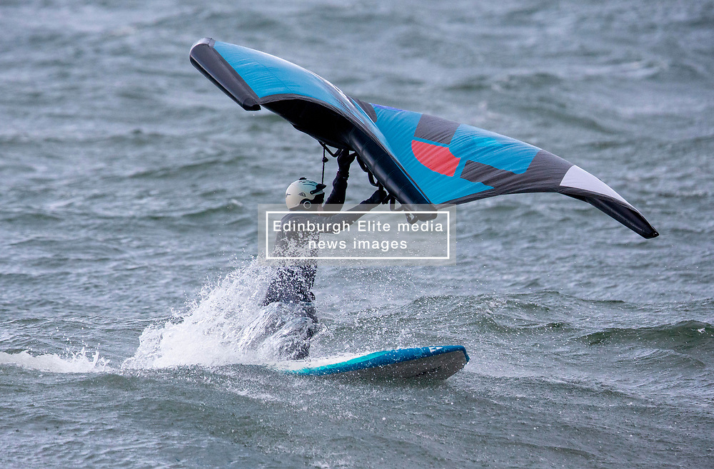 Wing Foiling is the latest-born board sport : it consists in managing a wing not attached to the board and carried with two hands while standing on a hydrofoil mounted on a short stand up paddle board. Enthusiasts were out in the sea at Ganavan Sands, Oban enjoying ideal conditions today.…….. (c) Stephen Lawson   Edinburgh Elite media