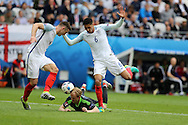 Jonathan Williams of Wales © falls under the challenge from England's Chris Smalling ® and Gary Cahill (l) in the penalty area but no penalty is given.  Euro 2016, group B , England v Wales at Stade Bollaert -Delelis  in Lens, France on Thursday 16th June 2016, pic by  Andrew Orchard, Andrew Orchard sports photography.