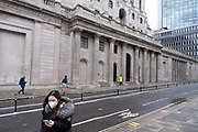 With very few people out and about the scene in the City of London financial district is one of empty desolation outside the Bank of England as the national coronavirus lockdown three continues on 29th January 2021 in London, United Kingdom. Following the surge in cases over the Winter including a new UK variant of Covid-19, this nationwide lockdown advises all citizens to wear a face mask, follow the message to stay at home, protect the NHS and save lives.