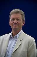 British journalist and writer Peter Popham, pictured at the Edinburgh International Book Festival where he talked about his biography of Burma politician Aung San Suu Kyi. The three-week event is the world's biggest literary festival and is held during the annual Edinburgh Festival. The 2012 event featured talks and presentations by more than 500 authors from around the world.