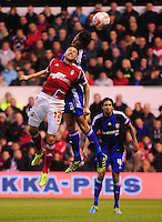 Middlesbrough's George Friend goes up for a header with Nottingham Forest's Jamie Mackie <br /> <br /> Photo by Chris Vaughan/CameraSport<br /> <br /> Football - The Football League Sky Bet Championship - Nottingham Forest v Middlesbrough - Tuesday 17th September 2013 - The City Ground - Nottingham<br /> <br /> © CameraSport - 43 Linden Ave. Countesthorpe. Leicester. England. LE8 5PG - Tel: +44 (0) 116 277 4147 - admin@camerasport.com - www.camerasport.com