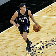 ORLANDO, FL - APRIL 07: R.J. Hampton #13 of the Orlando Magic dribbles the ball up the court against the Washington Wizards at Amway Center on April 7, 2021 in Orlando, Florida. NOTE TO USER: User expressly acknowledges and agrees that, by downloading and or using this photograph, User is consenting to the terms and conditions of the Getty Images License Agreement. (Photo by Alex Menendez/Getty Images)*** Local Caption *** R.J. Hampton