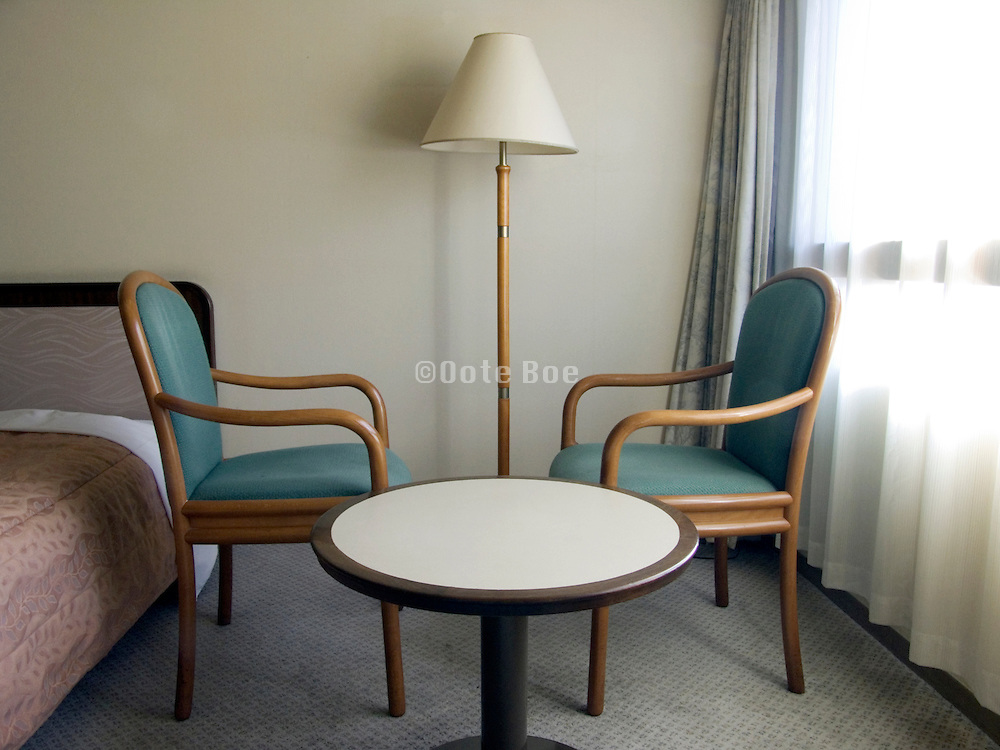 hotel room in the morning with two chairs facing each other