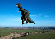 "A 129-foot-tall (39 m) T.rex hot-air balloon, owned by Thunder and Colt Balloons, glides over Dinosaur Provincial Park.<br /> A 129-foot-tall (39 m) T.rex hot-air balloon, owned by Thunder and Colt Balloons comes to a rest and the hot air is released by paleontologist Phil Currie (far right in field) who was riding in the gondola.<br /> T. Rex, ""tyrant lizard king,"" was one of the largest-ever meat eating land animals.  The bi-pedal giant grew to some 40 feet (12 meters) and weighed up to 7 US tons (6.5 metric tons) and small two-fingered hands that were actually surprisingly strong."