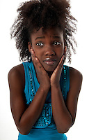 African american girl with a very worried expression.